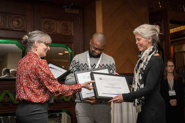 Dr Huff and Dr. Odoh receive awards